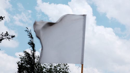 A White Flag Swaying By The Wind Blows