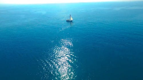 A Sailboat Out In The Open Sea