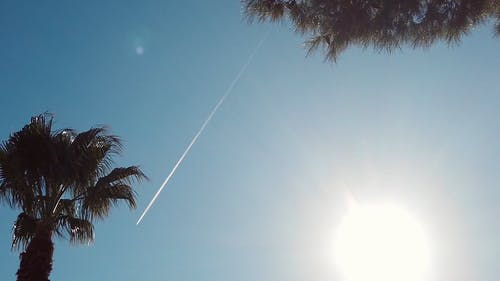 A Condensation Trail Produced In The Air By A Flying Jet Plane