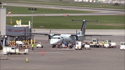 Passenger Disembarking From A Turboprop Passenger Plane In Montreal Airport