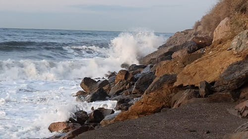 Sea Waves Crashing The Rocks Formation