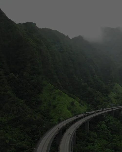 Motor Vehicles Traffic On A Mountain Road