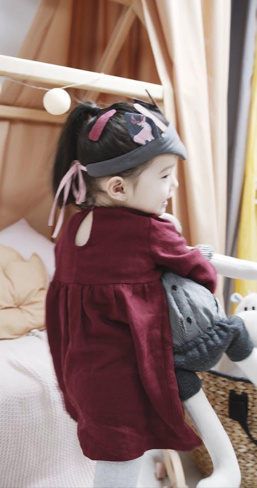 A Kid Cuddling A Stuffed Toy
