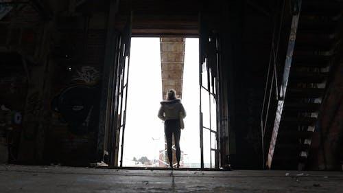 Woman Standing On A Doorway Feeling Sad