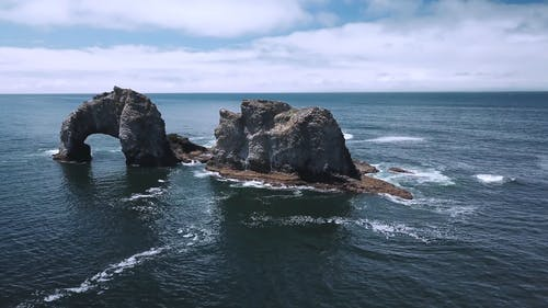 Drone Footage Of A Rock Formation In The Middle Of The Sea