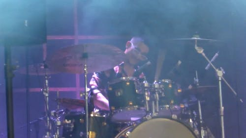 A Drummer Performing Live On Stage