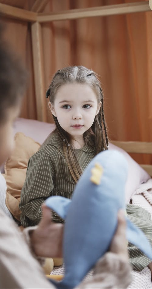 Girls Playing With Stuff Toy Animals