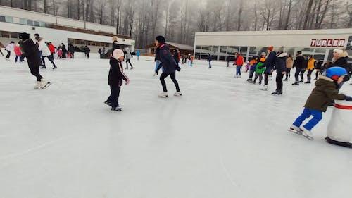 A Crowd Of People Skating In A Skating Rink