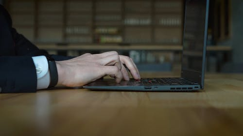 A Person Using A Computer Laptop