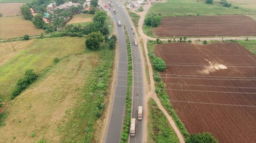 A Highway In The Middle Of An Agricultural Land,