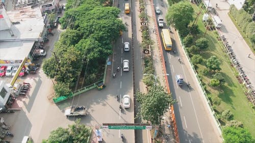 Top View Footage Of The Vehicles Crossing The Roads