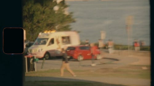 An Ice Cream Truck Selling In A Park By The Bay