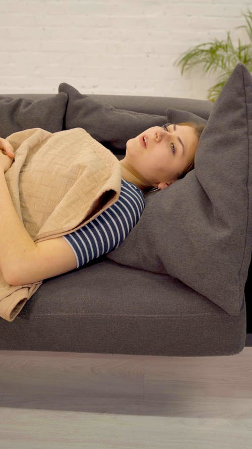 Woman Trying To Relax In the Sofa