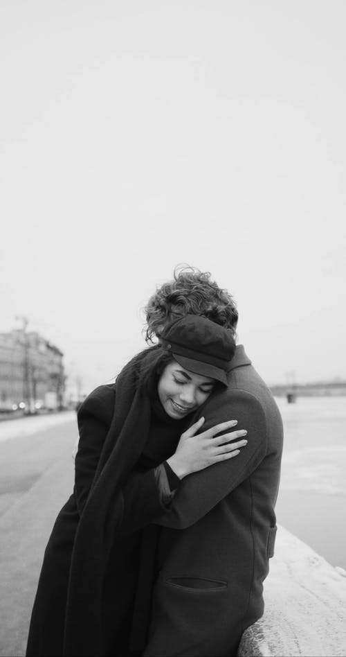 Sweet Moments Of A Couple Embracing Each Other In A Public Place