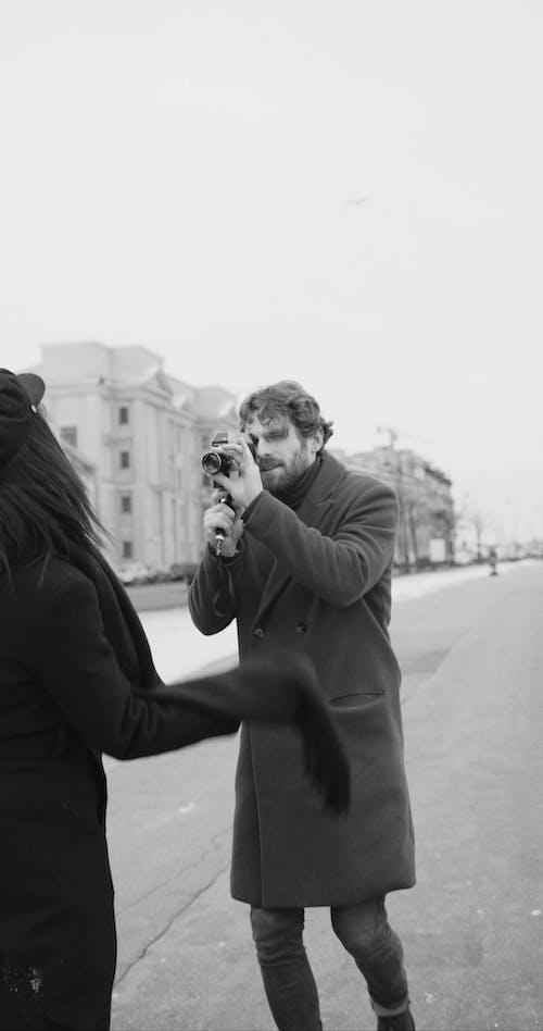 A Man Recording His Partner With A Video Camera While Having An Outdoor Fun