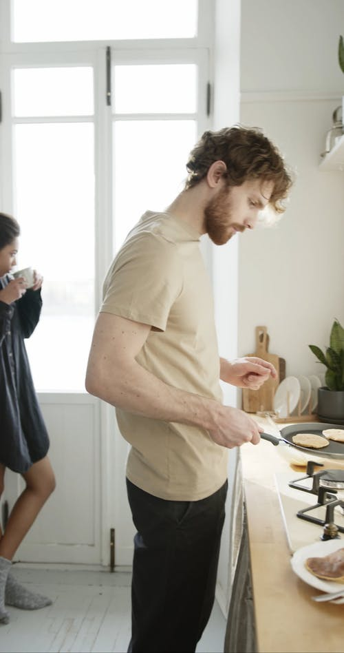 A Man Making Pancakes For Breakfast