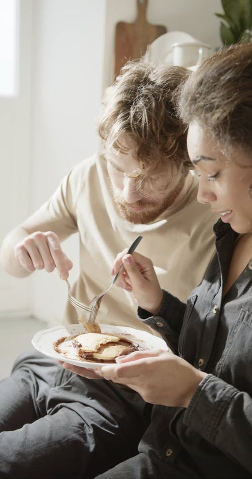 A Couple Sweet Moments While Eating Pancakes