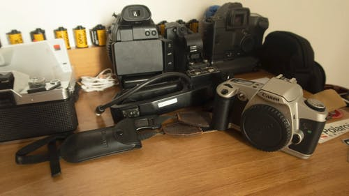 A Variety Of Cameras On The Table