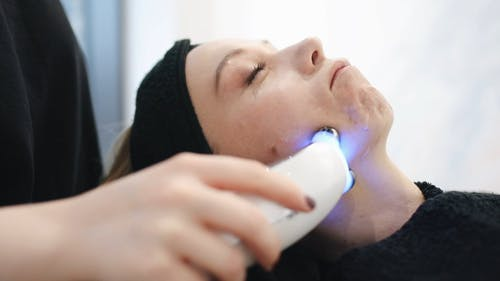 A Person Is Having An Ultrasonic Facial Massage