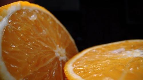 An Orange Fruit Cut In Half