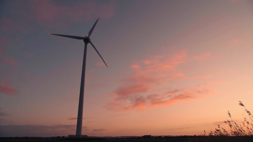 A Windmill In Operation For Renewable Energy Production