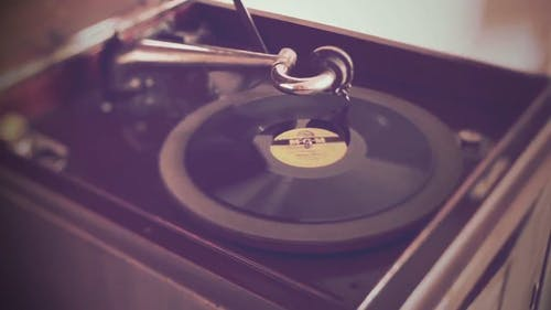 An Old Style Turntable Playing A Vinyl Record