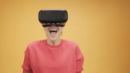Footage Of A Woman Using A Virtual Reality