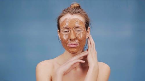 Woman with Brown Mud Mask
