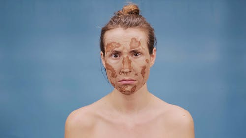 Woman with Dry Mud Mask