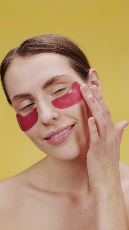 Woman Removing The Under Eye Mask
