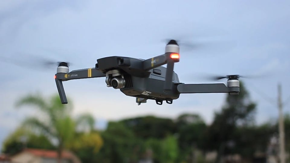 Full Shot And Close Up Footage Of A Flying Drone Machine