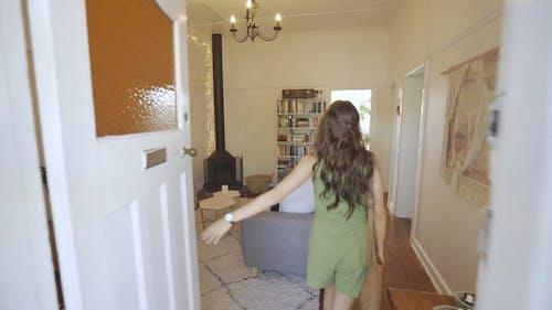 A Woman Entering a Living Room