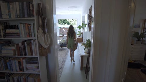 A Woman Going Outside a House