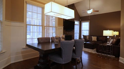 Tracking Shot of a Dining Table beside a Living Area