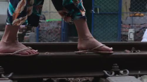 Person Walking On A Railway