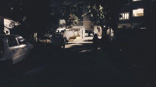 A Person Walking Down a Dark Street