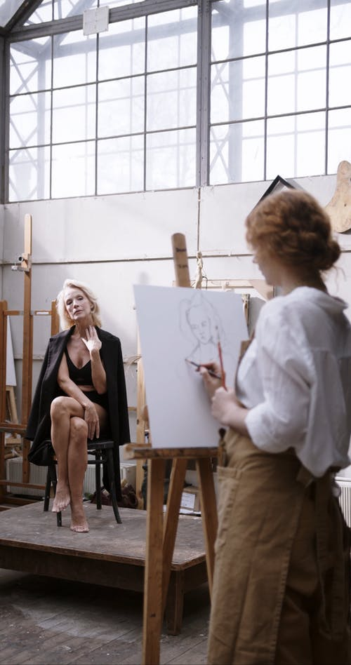 A Woman Posing For A Canvass Painting