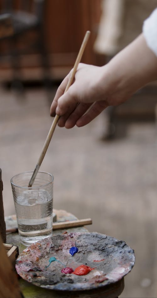 Washing A Paint Brush On  A Glass Of Water