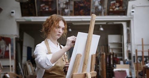 Woman Artist Doing A Portrait