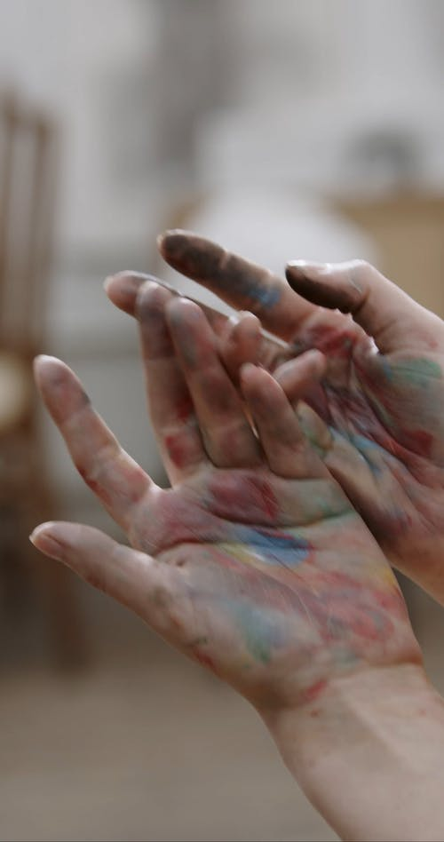 A Woman's Hand Full Of Paint Stain