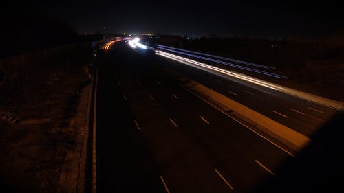 High Angle Of A High Speed Footage Of Vehicle Passing By In The High Way