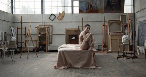 A Woman In Her Underwear Modeling Inside A Studio