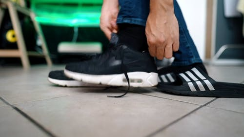 Person Tying Shoelaces