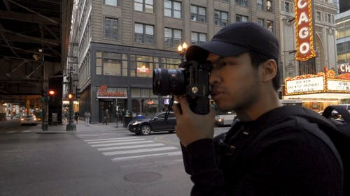 A Young Photographer Engaged In City Photography
