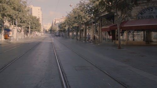 Slow Motion Footage Of The Street And A Man Running