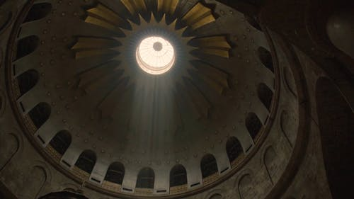 Sunlight Passing Through A Dome Ceiling Of A Cathedral