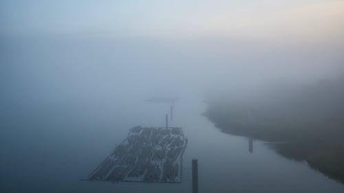 Footage Of The Lake Covered With Fog