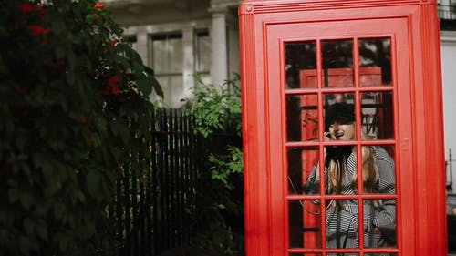 Footage Of Woman Using Phone Booth