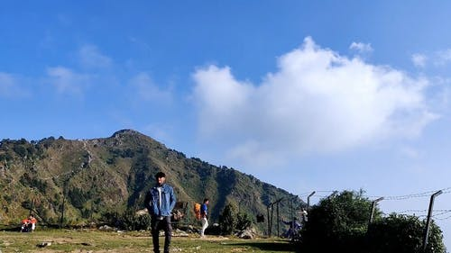 Timelapse Of People On A Mountain Under Blue Sky