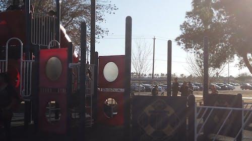 Children Having Fun In The Playground